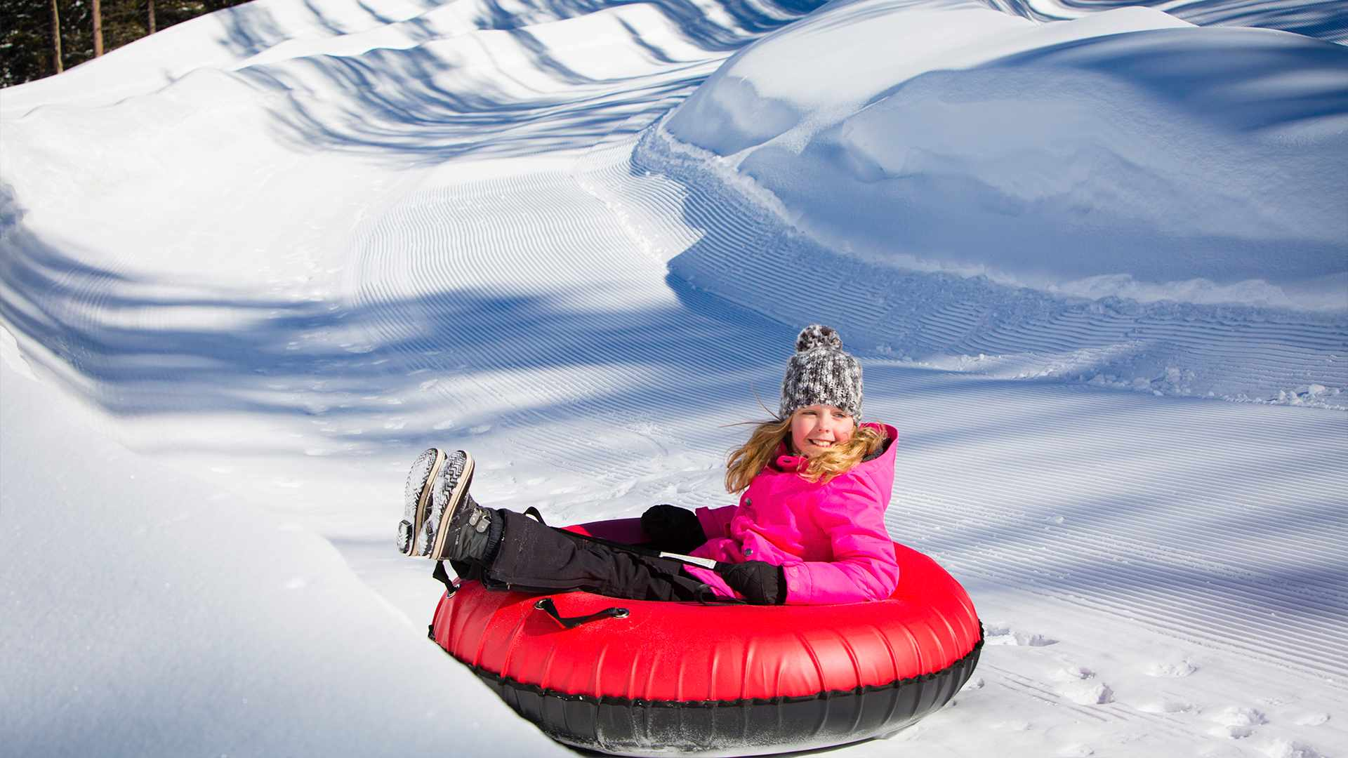 Snow Tubing - Trade in your skis or board for a tube and hit the snow tubing hill located at the top of the Elk Camp Gondola.